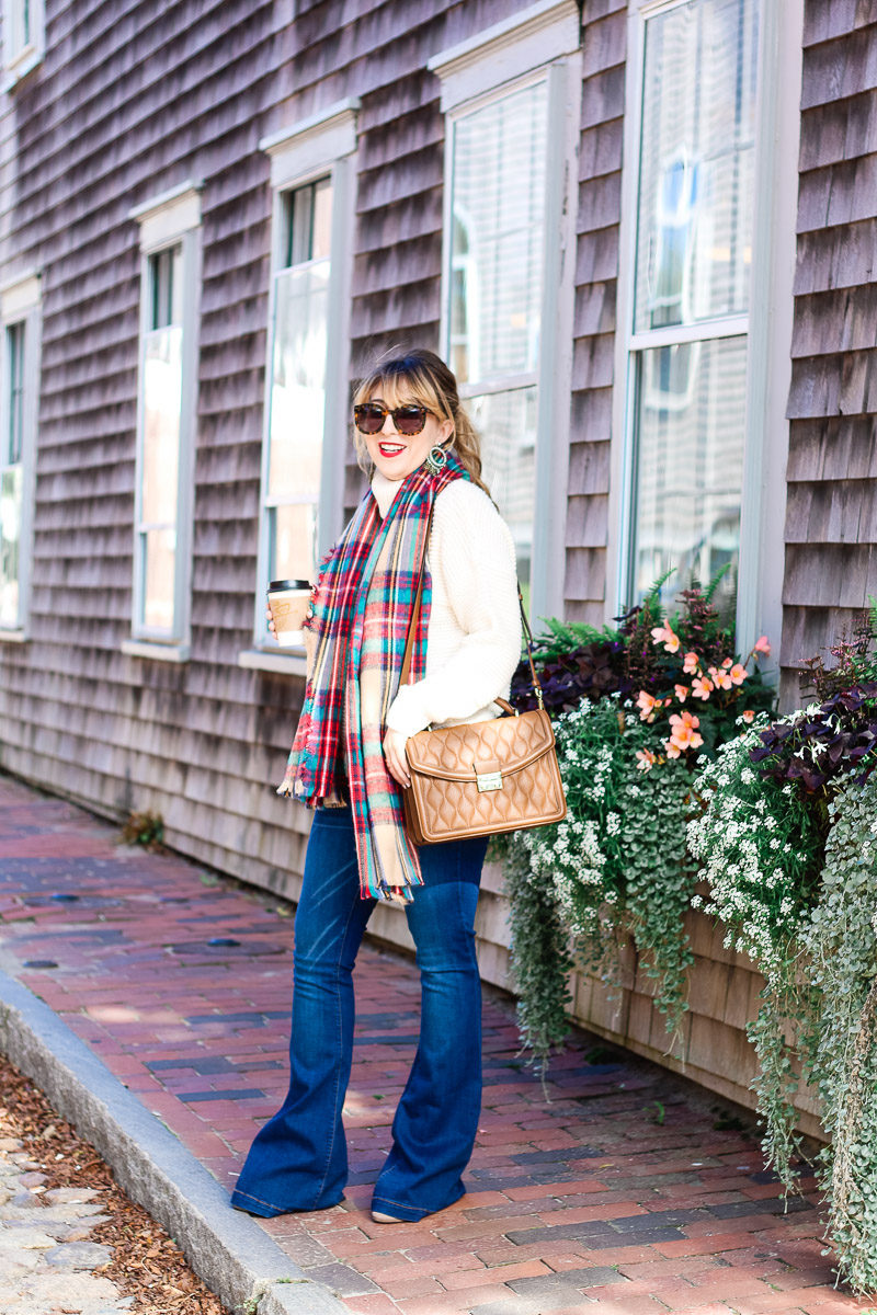 Miami fashion blogger Stephanie Pernas of A Sparkle Factor pairs a comfy turtleneck sweater with jeans and a plaid blanket scarf for a cute fall outfit idea
