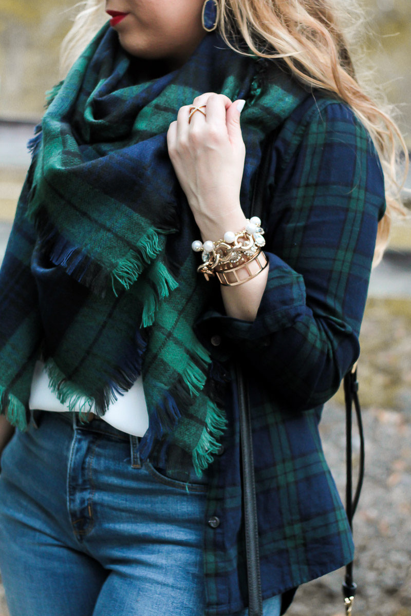 Fashion blogger Stephanie Pernas of A Sparkle Factor styles a chic bracelet stack with mixed watch plaids for a cute casual holiday outfit idea