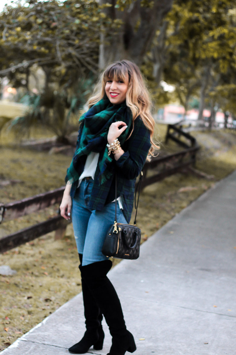 Fashion blogger Stephanie Pernas wears black over the knee boots and a black watch plaid scarf and button down