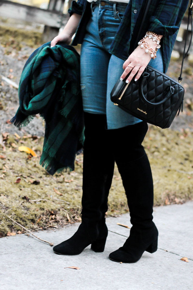 Miami fashion blogger Stephanie Pernas of A Sparkle Factor styles the Sole Society Leandra boots with jeans for a casual plaid holiday outfit idea