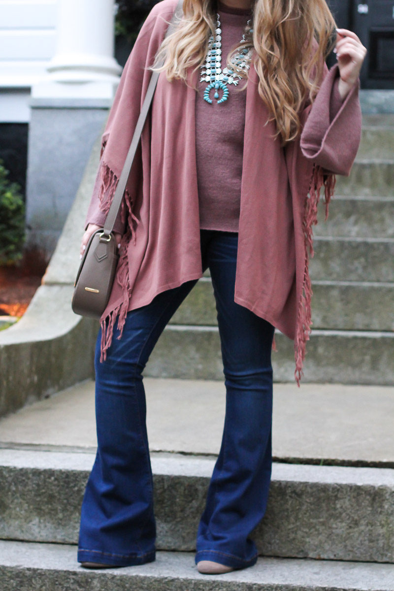 Miami fashion blogger styles flare jeans and a fringe shawl for fall