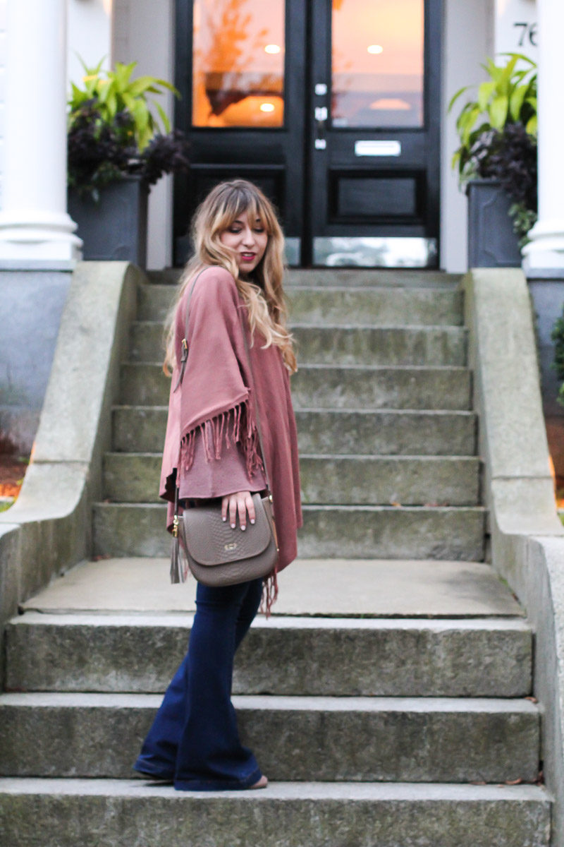 Miami fashion blogger Stephanie Pernas styles the GiGi New York Kelly saddlebag with flares and a bell sleeve sweater