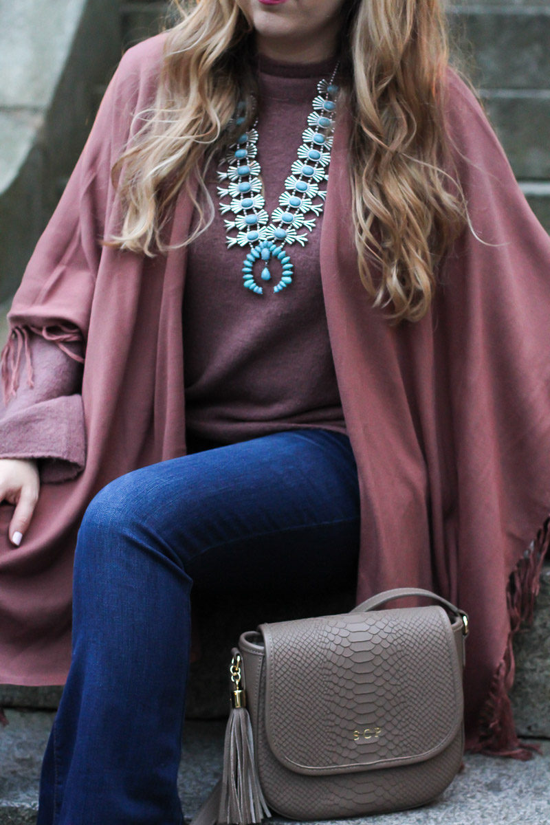 Miami fashion blogger Stephanie Pernas of A Sparkle Factor wearing a fringe shawl and bell sleeve sweater for a boho fall outfit idea