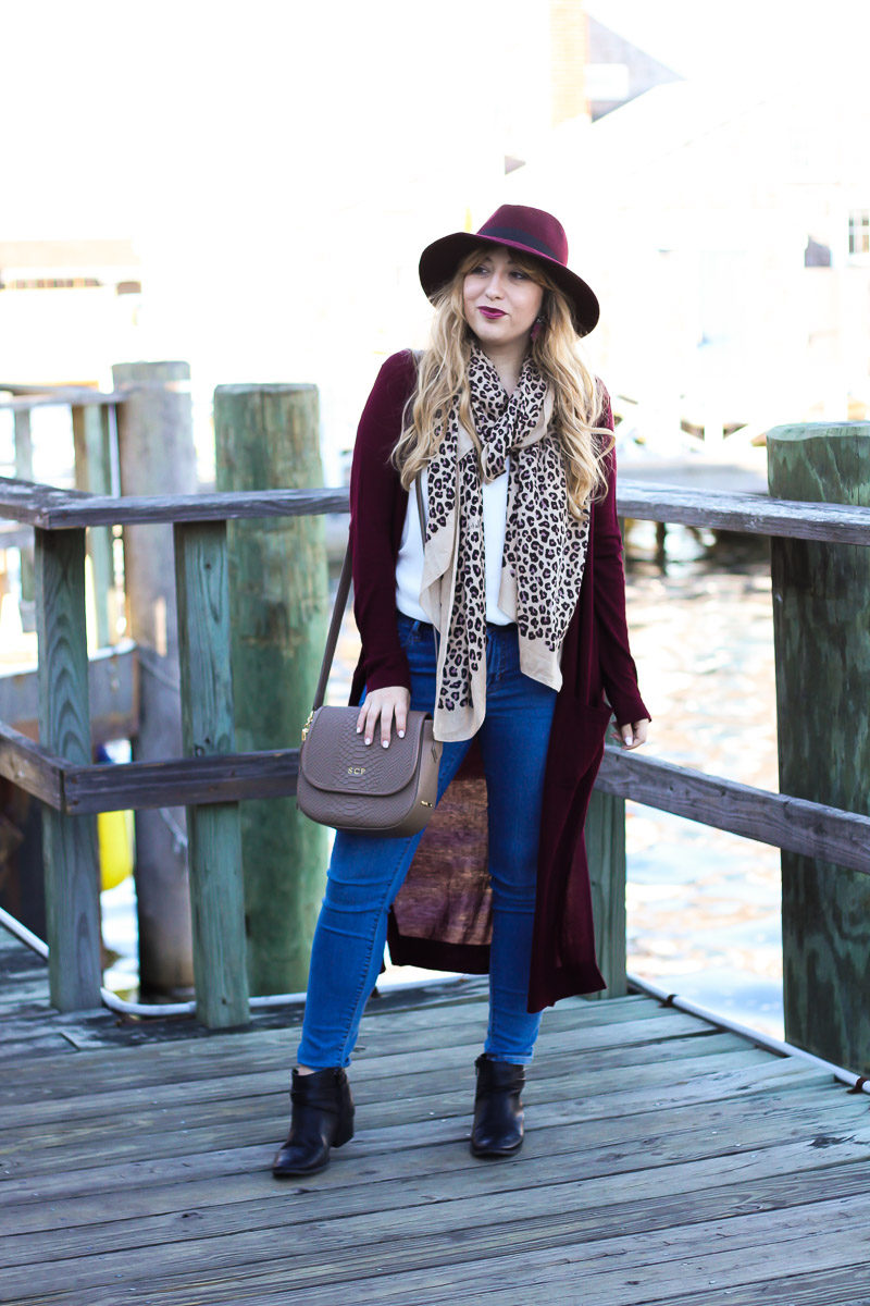 Miami fashion blogger Stephanie Pernas styles a cozy leopard scarf with a long cardigan, jeans, and booties
