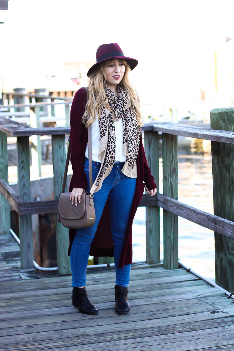 Miami fashion blogger shares fall outfit inspiration by styling a long cardigan with a fedora and leopard scarf