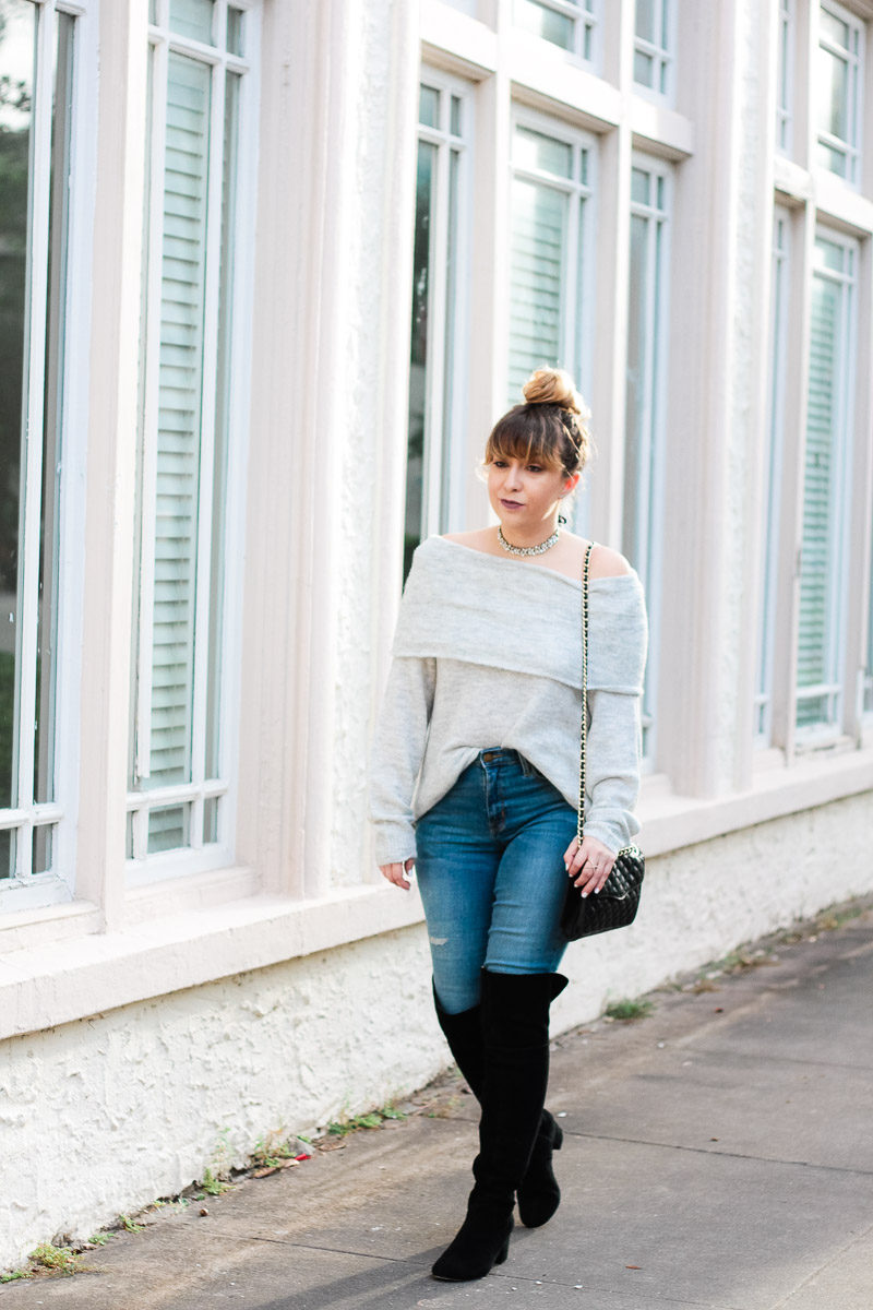Miami fashion blogger Stephanie Pernas of A Sparkle Factor wearing a sweater, jeans and boots