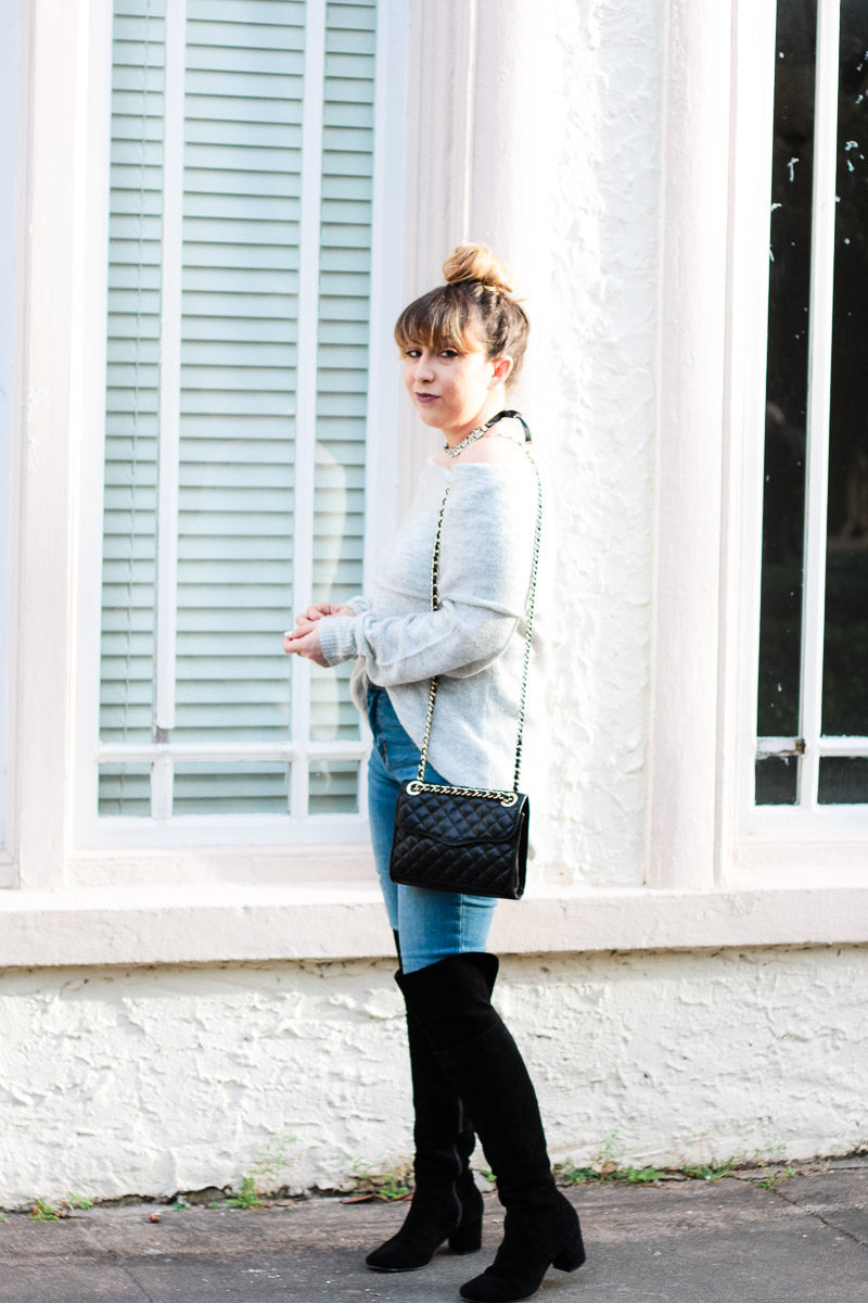 Miami fashion blogger Stephanie Pernas wearing a cozy gray sweater and jeans with over the knee boots
