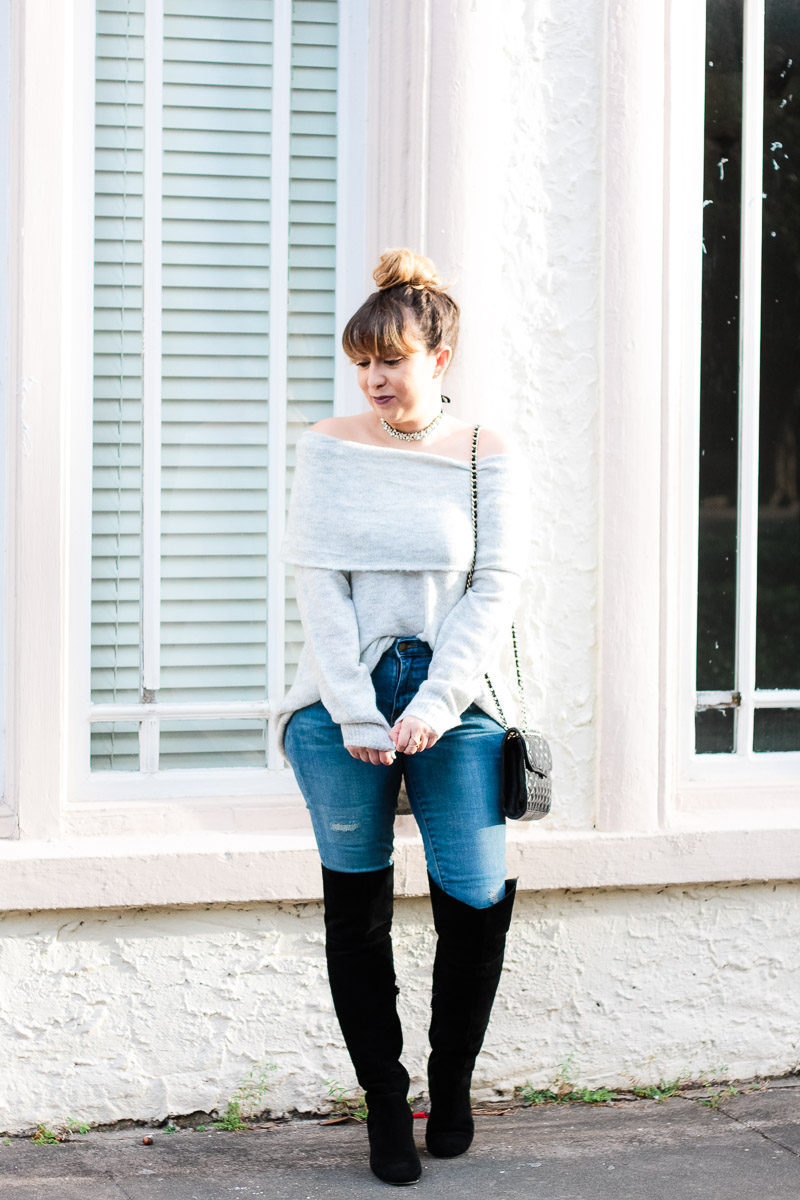 Miami fashion blogger Stephanie Pernas styles over the knee boots with jeans and an off the shoulder sweater for a cozy outfit idea