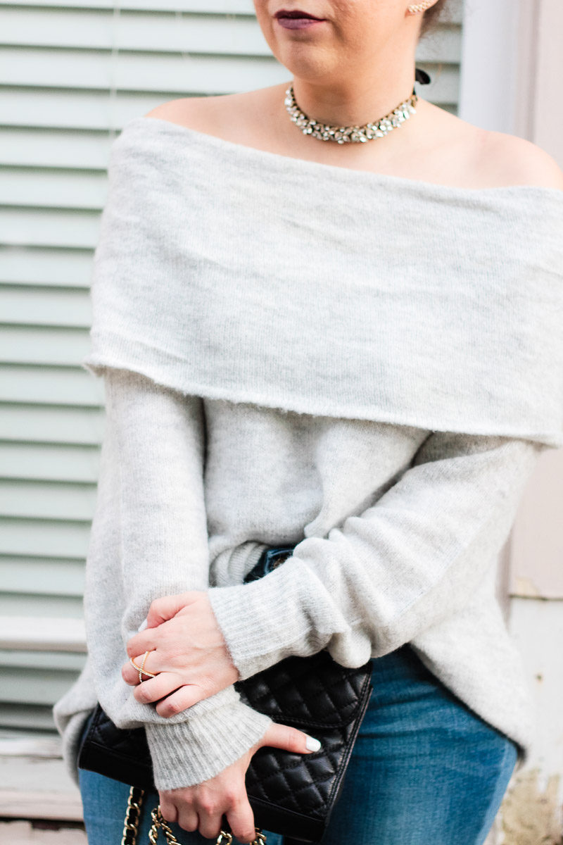 Miami fashion blogger Stephanie Pernas styles a cozy off the shoulder sweater with jeans and a choker