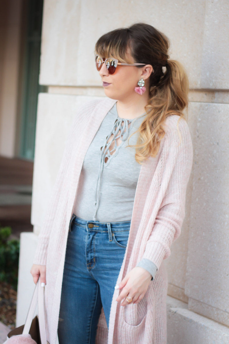 Miami fashion blogger Stephanie Pernas of A Sparkle Factor styles a casual fall outfit with lace up tee and boyfriend cardigan