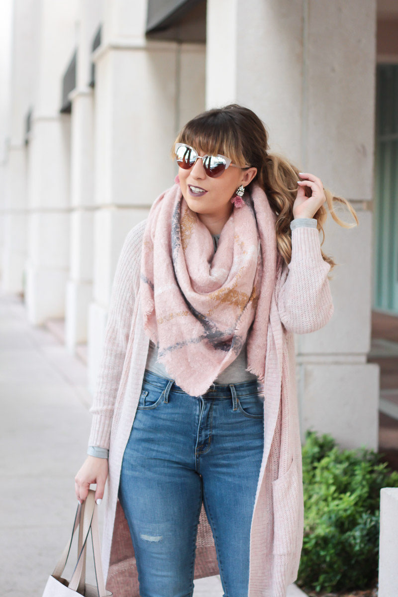 Miami fashion blogger Stephanie Pernas of A Sparkle Factor styles a blush cardigan with a matching blanket scarf for a casual fall outfit
