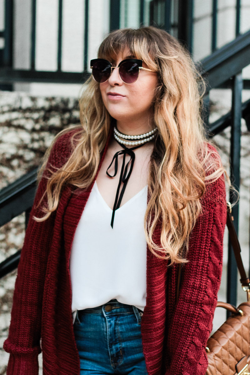 Miami fashion blogger Stephanie Pernas of A Sparkle Factor styles Baublebar Guinevere choker with a burgundy cable knit cardigan