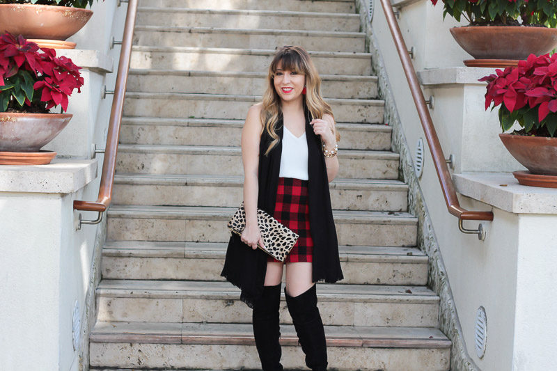 Miami fashion blogger Stephanie Pernas styles a buffalo plaid skirt outfit with Sole Society Leandra over the knee boots.