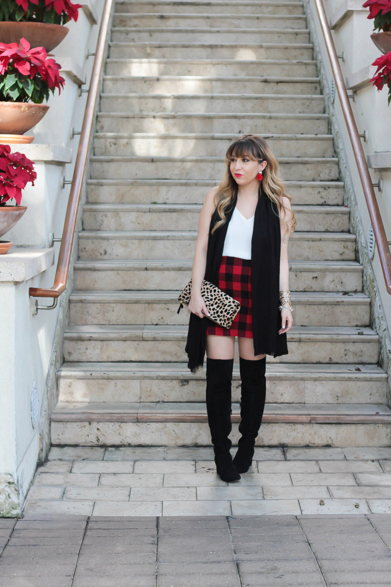 Miami fashion blogger Stephanie Pernas styling Sole Society over the knee boots with a holiday plaid skirt