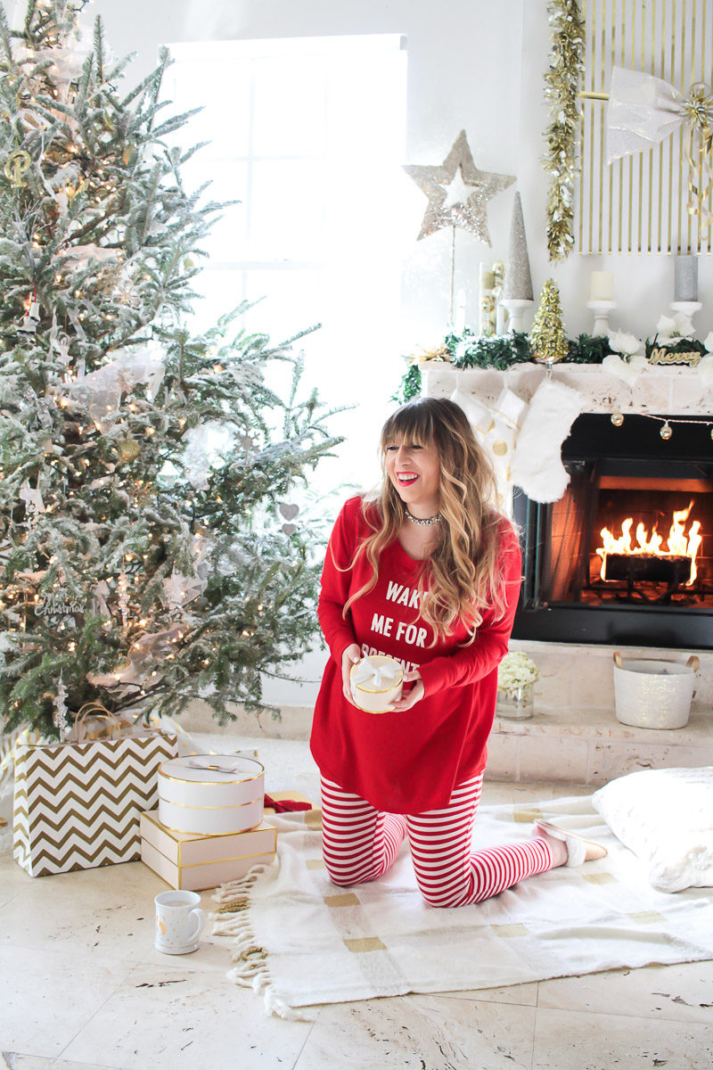 Fashion blogger Stephanie Pernas wearing cute Christmas pajamas for an adorable holiday look