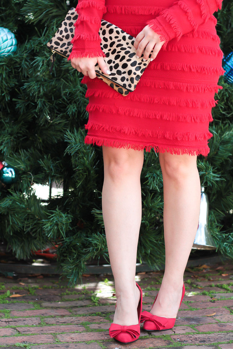 Miami fashion blogger Stephanie Pernas wearing red bow pumps and a red fringe Trina Turk sweater dress
