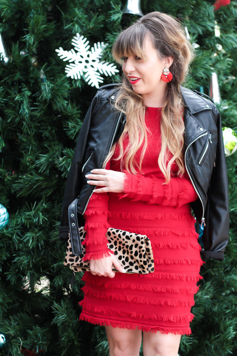 Miami fashion blogger Stephanie Pernas wearing Baublebar flamenco drops earrings and a red fringe sweater dress