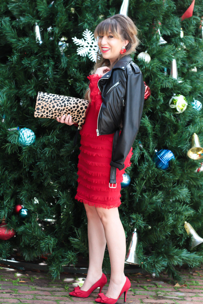 Miami fashion blogger Stephanie Pernas wearing a red fringe Trina Turk sweater dress for a chic holiday outfit idea