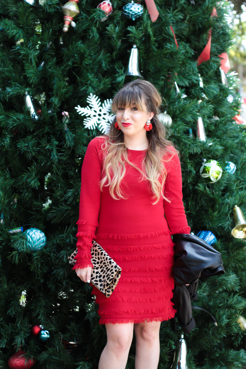 Miami fashion blogger Stephanie Pernas wearing the Trina Turk Sass sweater dress for a festive holiday outfit idea