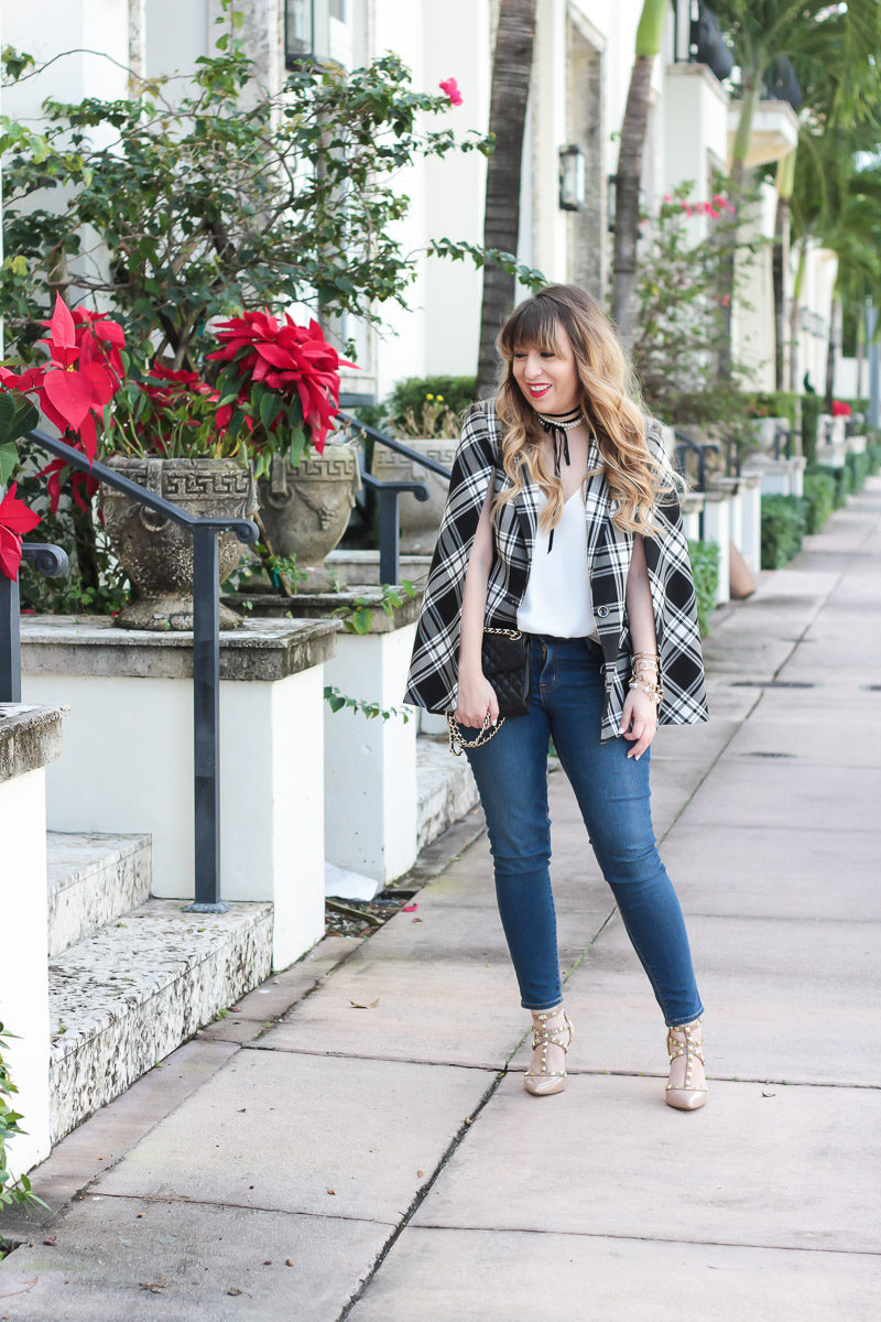 Miami fashion blogger Stephanie Pernas wearing a Trina Turk plaid cape blazer, jeans, and Sole Society Tiia pumps for a classic outfit idea