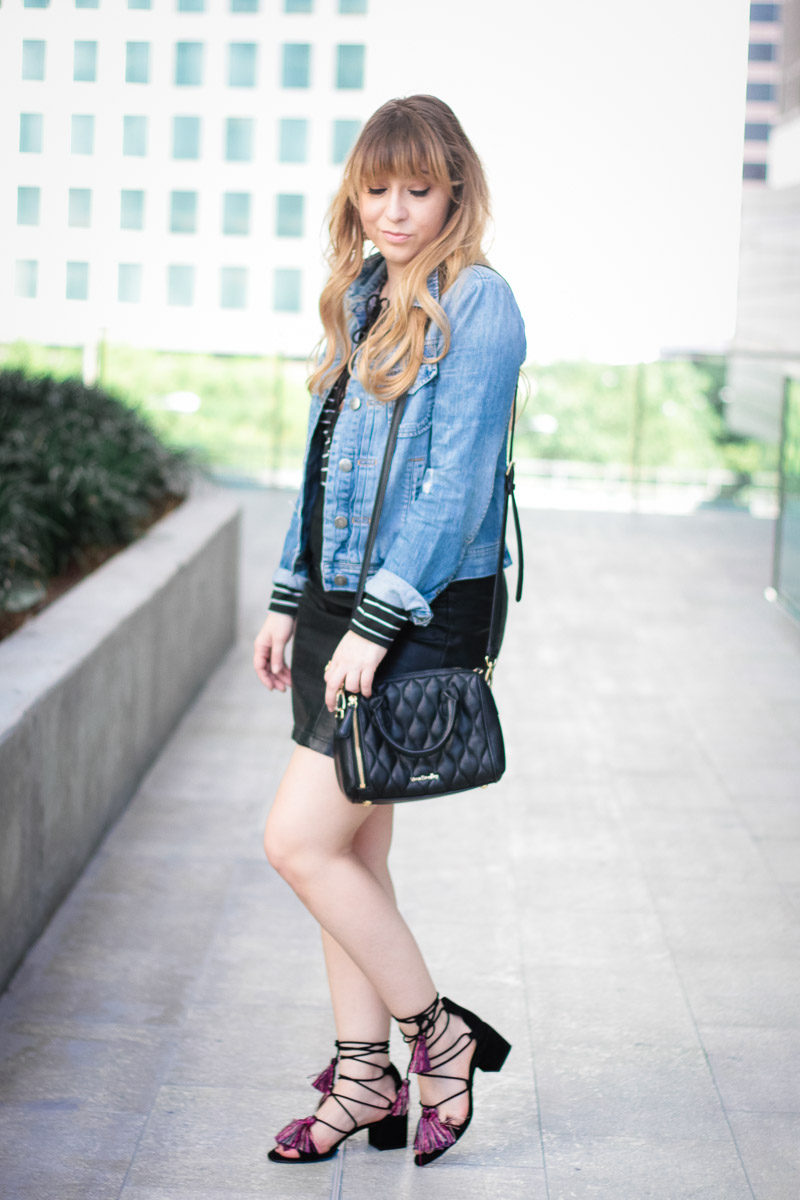 Miami fashion blogger Stephanie Pernas wearing a lace up body suit with leather skirt for a chic outfit idea