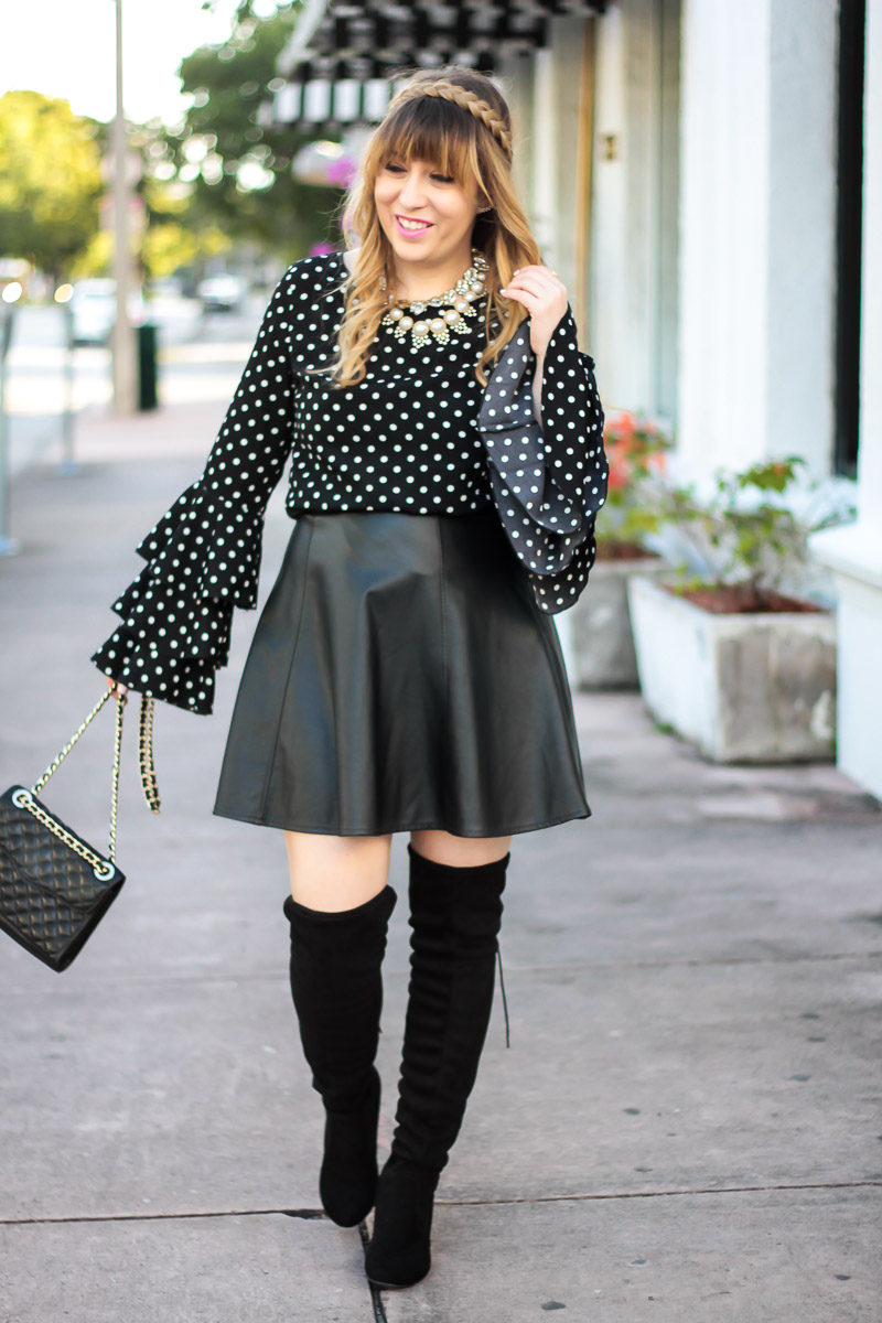 Miami fashion blogger Stephanie Pernas wearing a polka dot ruffle sleeve top with leather skirt and over the knee boots