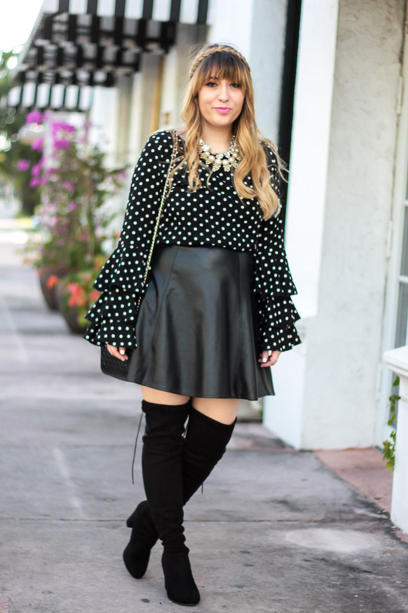 Fashion blogger wearing a cute polka dot ruffle top