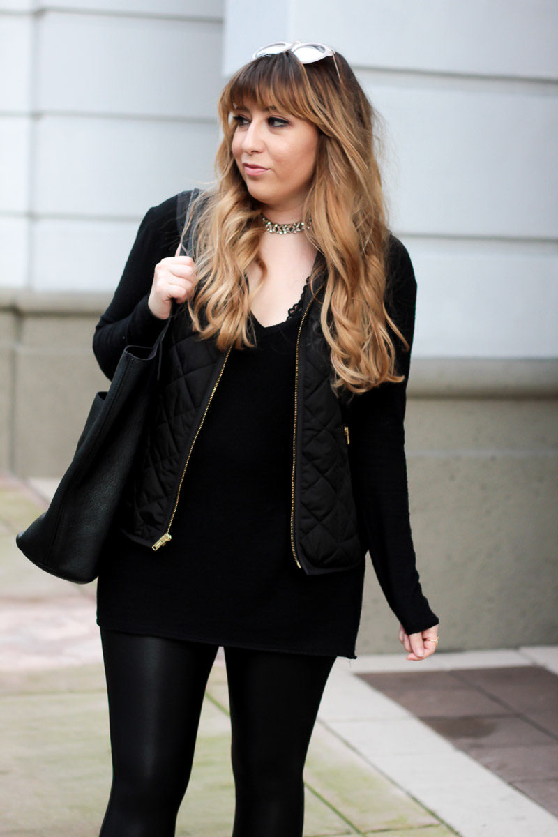 Miami fashion blogger Stephanie Pernas styles a quilted vest with Spanx leather leggings and a tunic for an easy casual outfit
