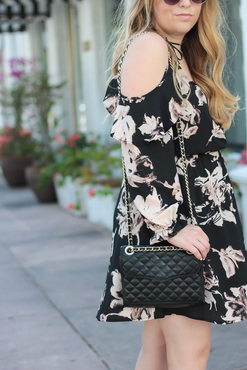 Miami fashion blogger Stephanie Pernas styling a Rebecca Minkoff Quilted Mini Affair bag with a floral cold shoulder dress