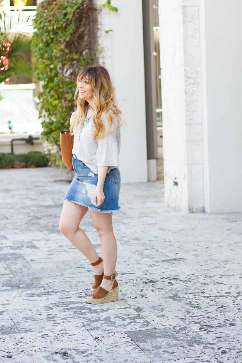 Distressed denim skirt outfit
