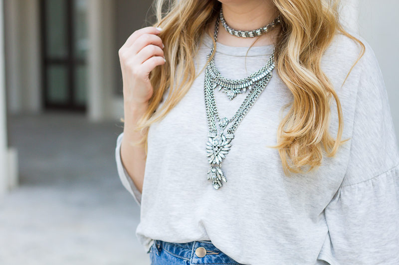 Miami fashion blogger Stephanie Pernas styles the Baublebar Supernova necklace with a gray tshirt for a casual spring outfit idea