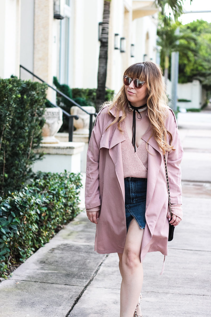 Miami fashion blogger Stephanie Pernas of A Sparkle Factor wearing a blush trench coat with jean skirt for a cute Valentine's Day outfit idea
