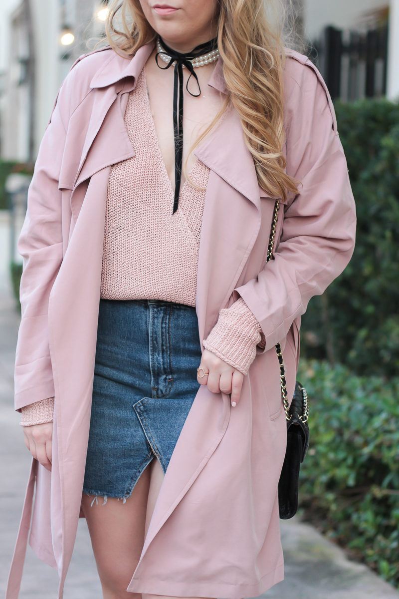 Miami fashion blogger Stephanie Pernas of A Sparkle Factor wearing a pink surplice sweater and trench coat with a denim skirt