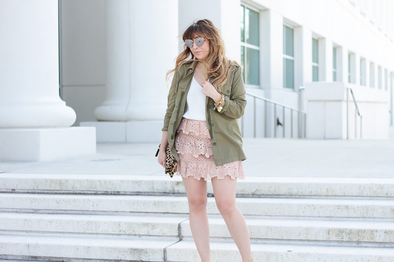Miami fashion blogger Stephanie Pernas wearing a pink lace skirt with a utility jacket for a casual spring outfit idea