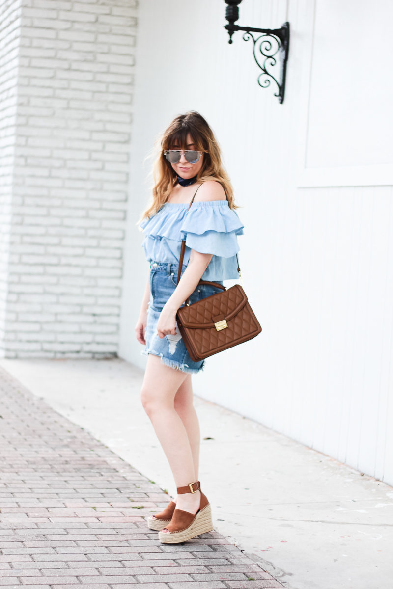 Miami fashion blogger Stephanie Pernas wearing a distressed jean skirt and off the shoulder top