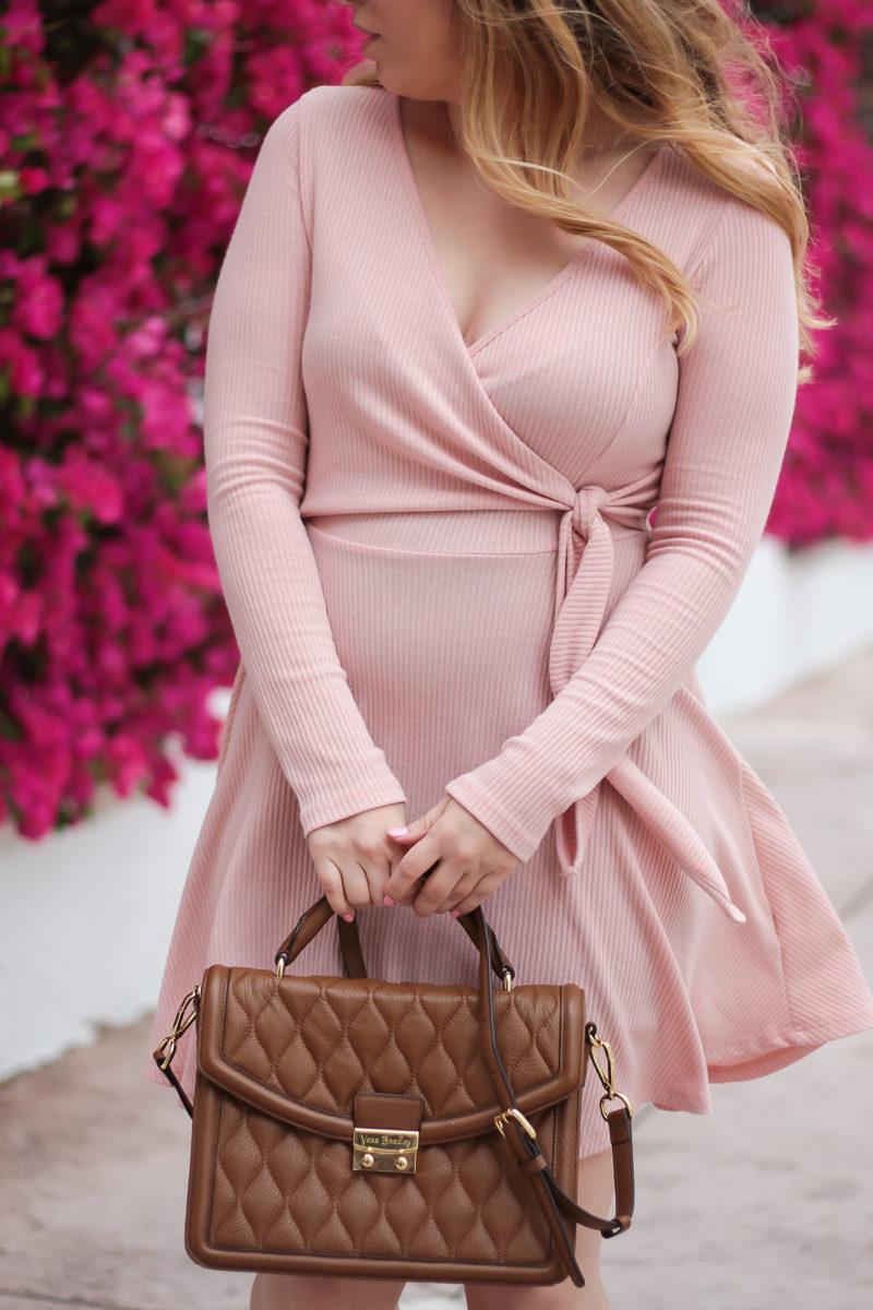 Miami fashion blogger Stephanie Pernas wearing a cute pink faux wrapdress