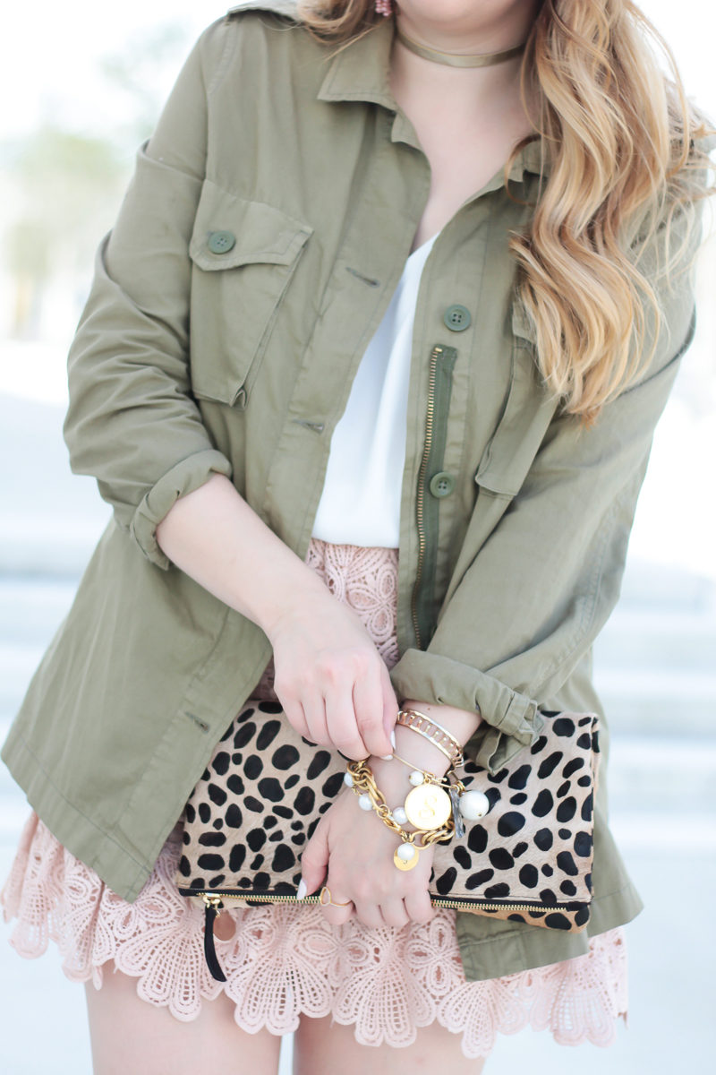Miami fashion blogger Stephanie Pernas styles a utility jacket with lace skirt and leopard clutch