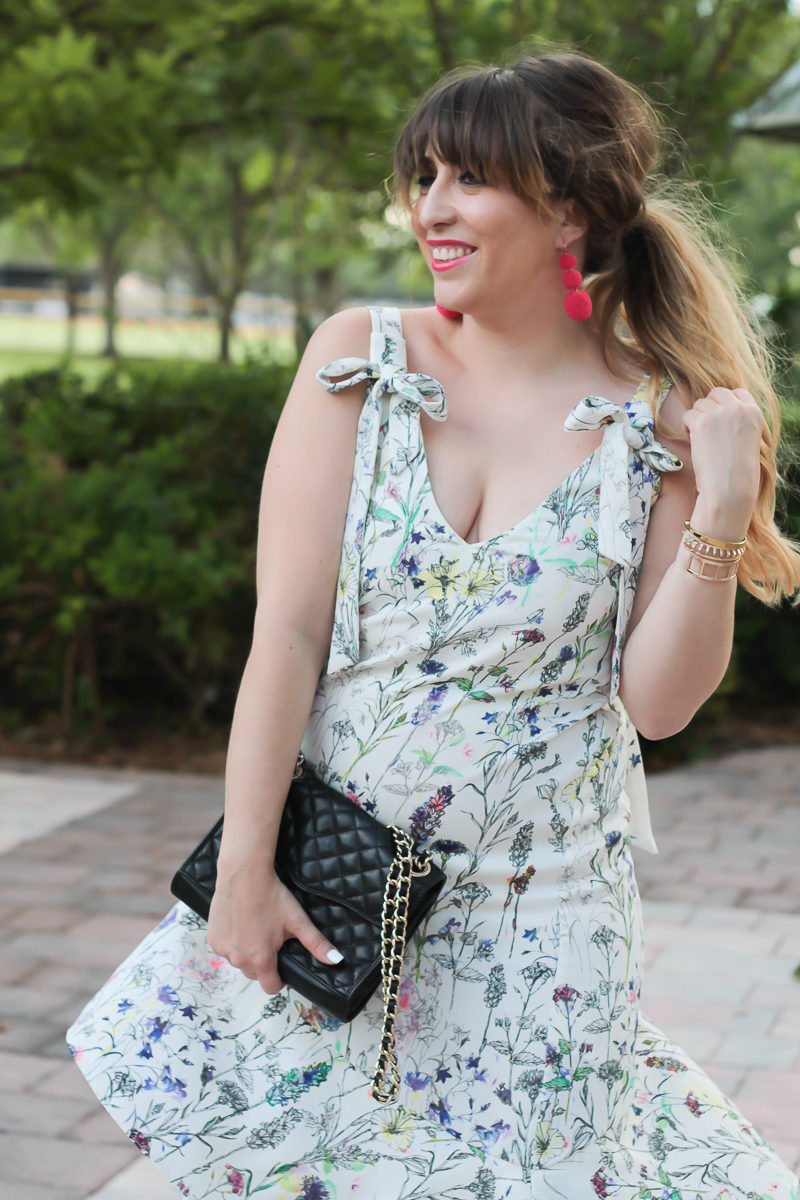 Miami fashion blogger Stephanie Pernas wearing a bow shoulder floral midi dress