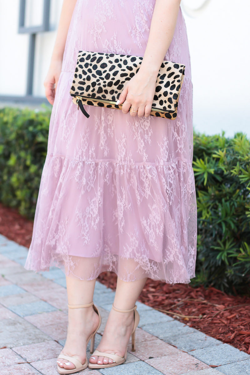 Miami fashion blogger Stephanie Pernas pairs a leopard clutch with a lilac lace dress for a pretty feminine Easter outfit idea.