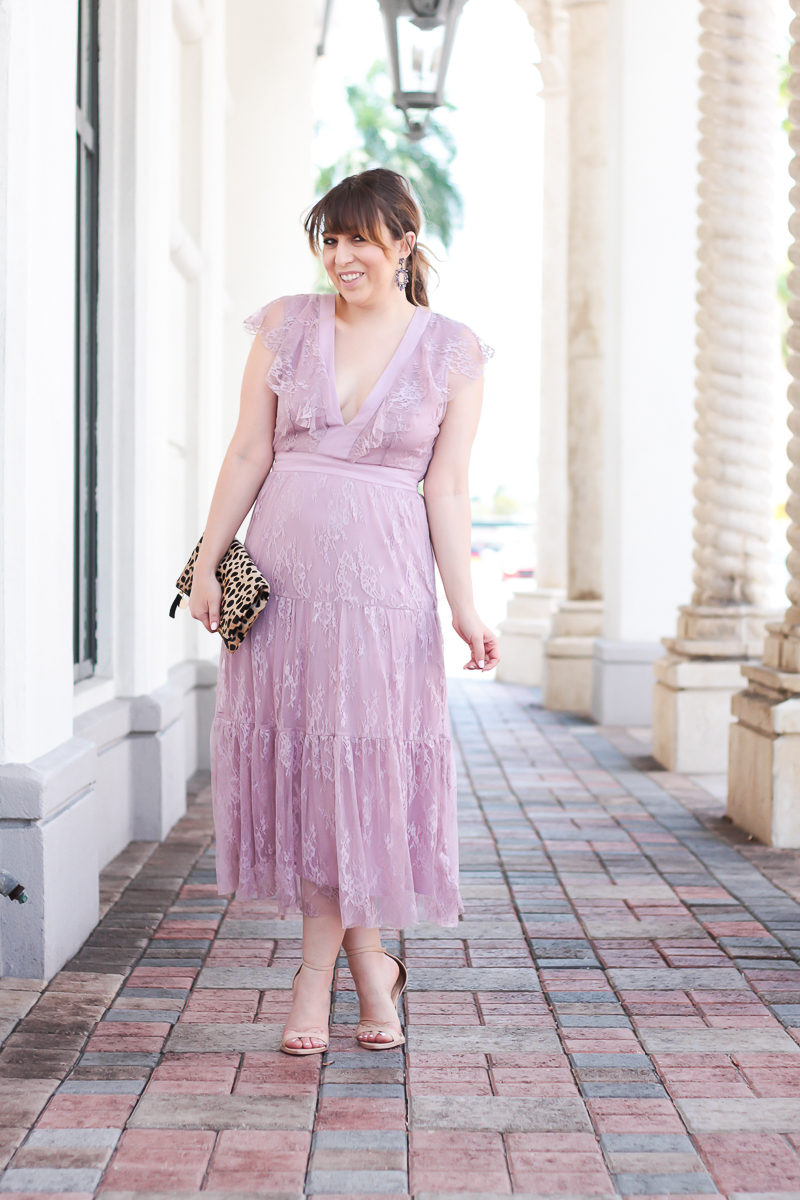 Miami fashion blogger Stephanie Pernas wearing a lilac lace dress with a leopard clutch