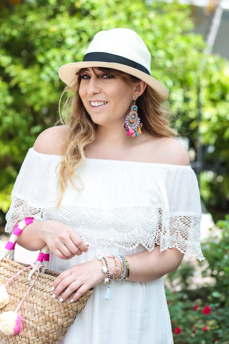 Miami fashion blogger Stephanie Pernas wearing a panama hat and off the shoulder white dress