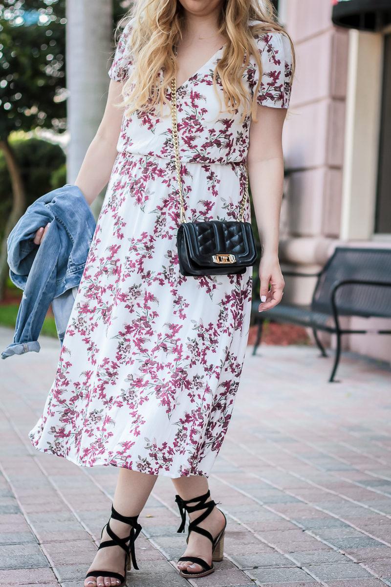 Miami fashion blogger Stephanie Pernas styling a Wayf floral midi dress