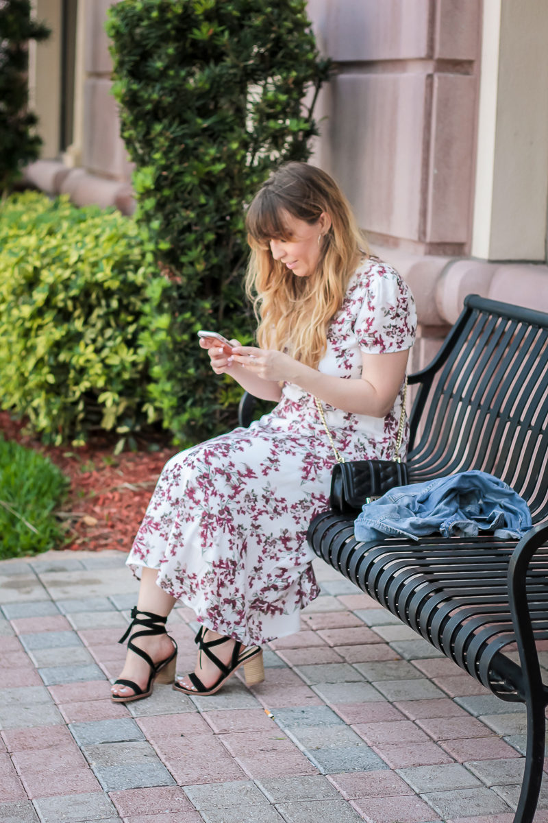 Miami fashion blogger Stephanie Pernas styles the Wayf blouson midi dress with a jean jacket
