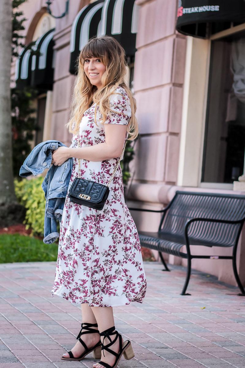 Miami fashion blogger Stephanie Pernas styles a floral midi dress and Rebecca Minkoff crossbody