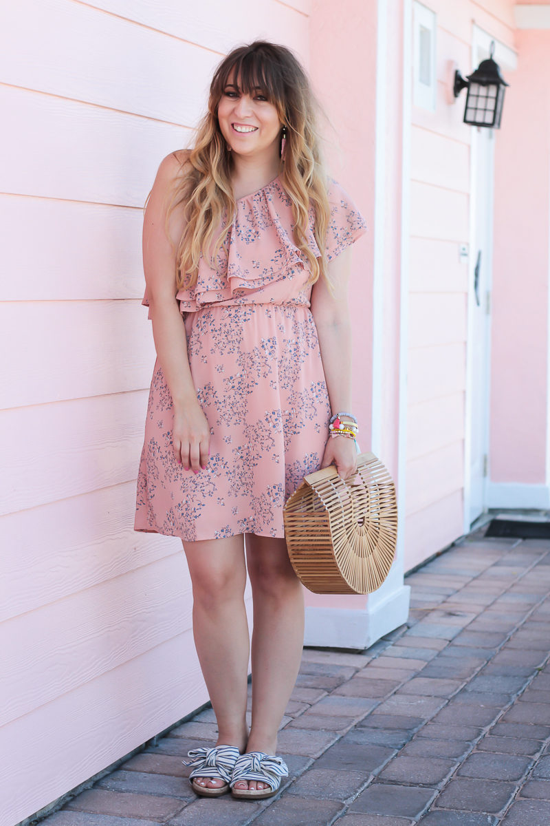 Miami fashion blogger Stephanie Pernas wearing a floral dress and stripe slides for a cute spring outfit idea