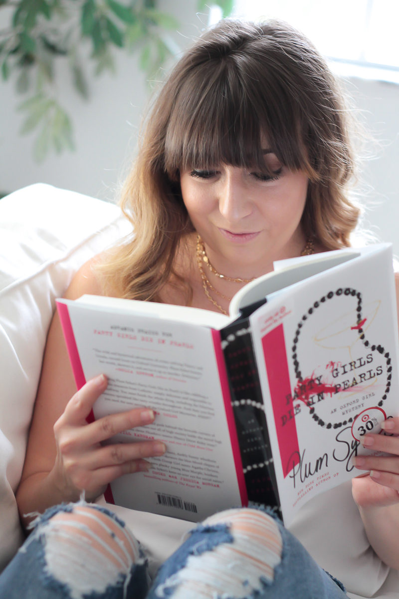 Miami fashion blogger Stephanie Pernas reading Party Girly Die in Pearls by Plum Sykes
