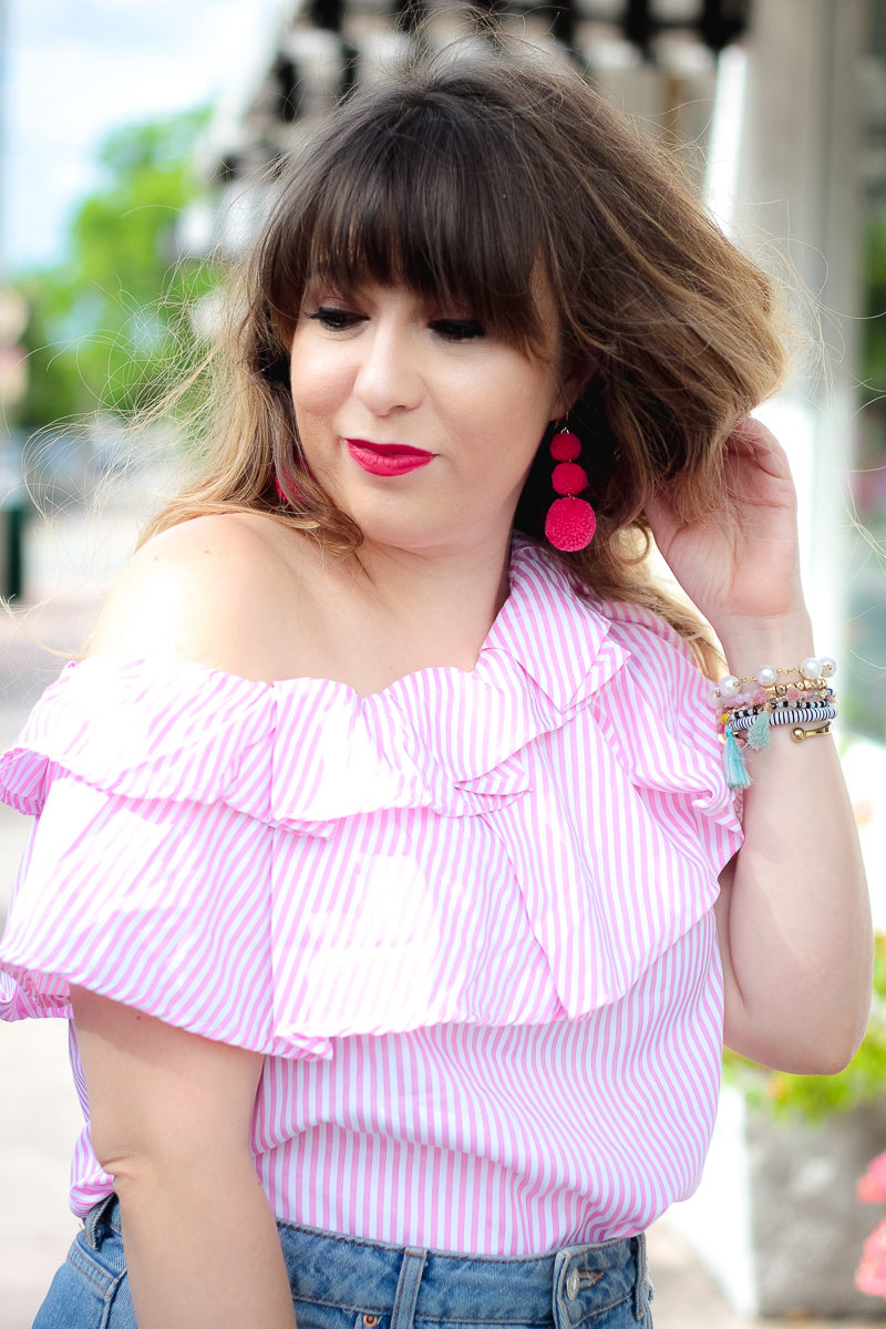Miami fashion blogger Stephanie Pernas wearing Baublebar Crispin Pom earrings and a one shoulder top