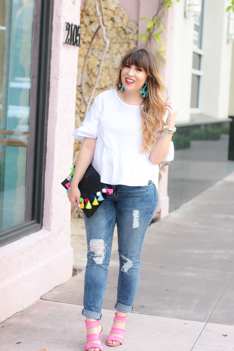 Miami fashion blogger Stephanie Pernas styles a white peplum top and jeans outfit for summer