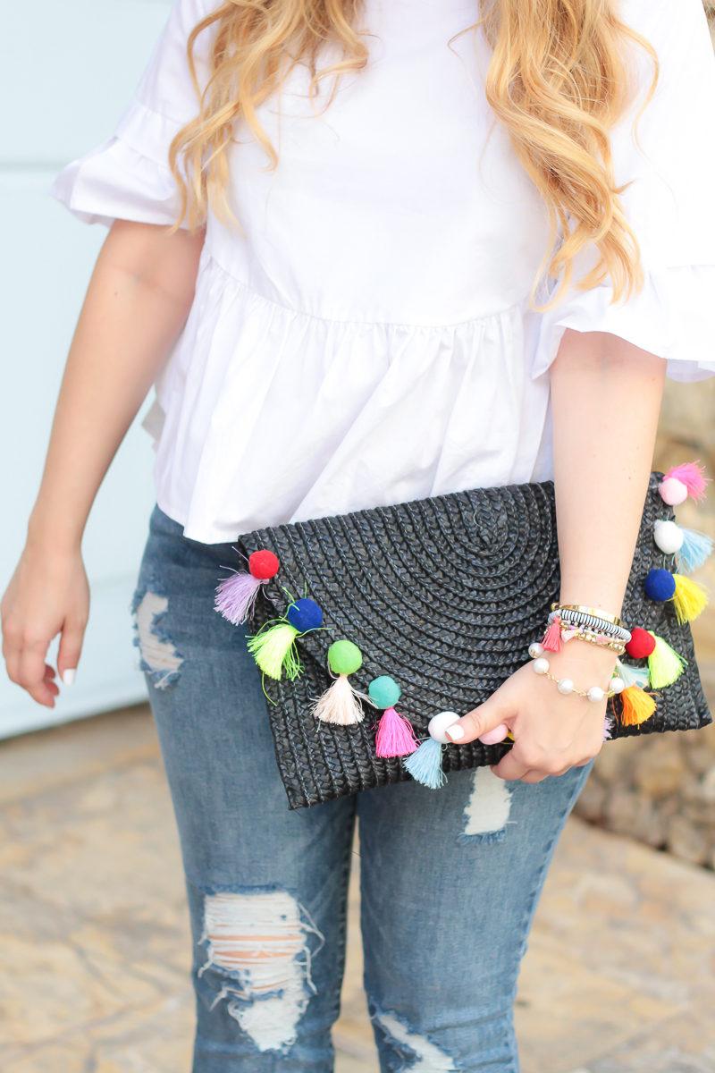 Miami fashion blogger Stephanie Pernas styles a cute straw pom pom clutch