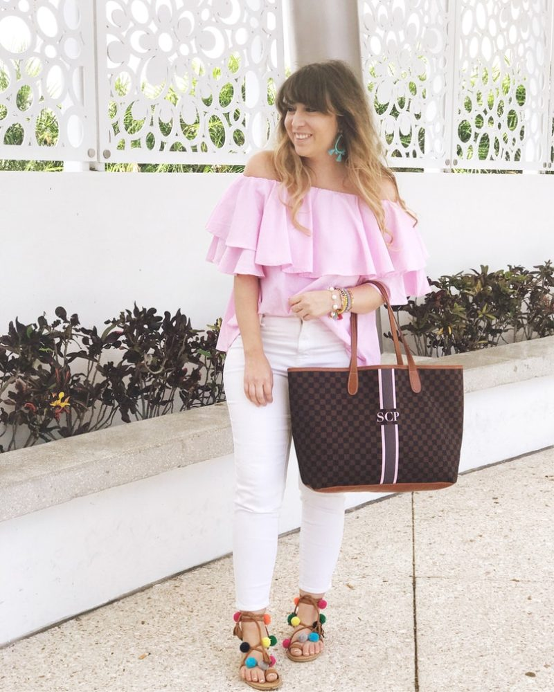 Miami fashion blogger Stephanie Pernas wearing a pink off the shoulder top and white jeans
